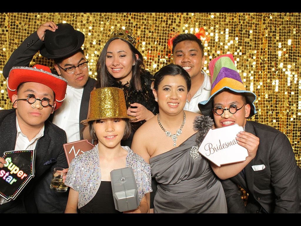 photo booth rental with gold backdrop